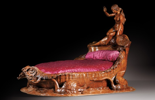 An exceptional carved mahogany bed, second half 19th-century. Estimate £500,000–800,000. The precise history of this unique commission remains shrouded in history, yet it has traditionally been associated with the legendary Hôtel de la Païva, the Champs-Elysée love nest of Esther Lachmann - the richest and most notorious demi-mondaine of the Second Empire. The matchless bateau-lit found its way into 'La Fleur Blanche', the notorious and celebrated brothel at 6 Rue des Moulins. Frequented by international high society, it was most notably where artist Henri de Toulouse-Lautrec set up his easel - in whose biography the bed is described in detail.
