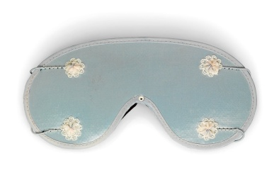 SLEEP SHADE CO. sleep mask, circa 1960 The blue satin shade applied with pink and blue lace-trimmed flowers, marked SLEEP SHADE CO., 282 MISSION ST, SAN FRANCISCO, CAL £100 - £150