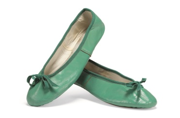 Three pairs of leather ballet pumps, circa 1960 One pair in burgundy trimmed with red ribbon; one in daffodil yellow with yellow ribbon and one pair in emerald green trimmed with Petersham ribbon. By family tradition, these shoes were acquired from Capezio. Audrey Hepburn's son Sean remembers 'bundles of these shoes arriving, folded flat, fastened by a rubber band' and he suggests Hepburn may well have bought them en masse from Capezio, when her favourite model was discontinued. £6,000 - £9,000