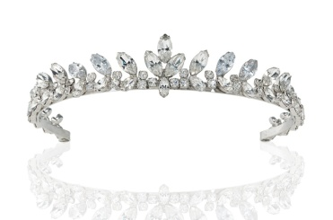 A colourless paste tiara composed of a continuous series of graduated navette and circular shaped paste, to close-back settings on a sprung frame; worn by Audrey Hepburn to the London premiere of The Nun's Story, July 1959 and as Joanna Wallace in the 1967 20th Century Fox production Two For The Road 11 ¼ in. (29 cm.) inner circumference £7,000 - £10,000
